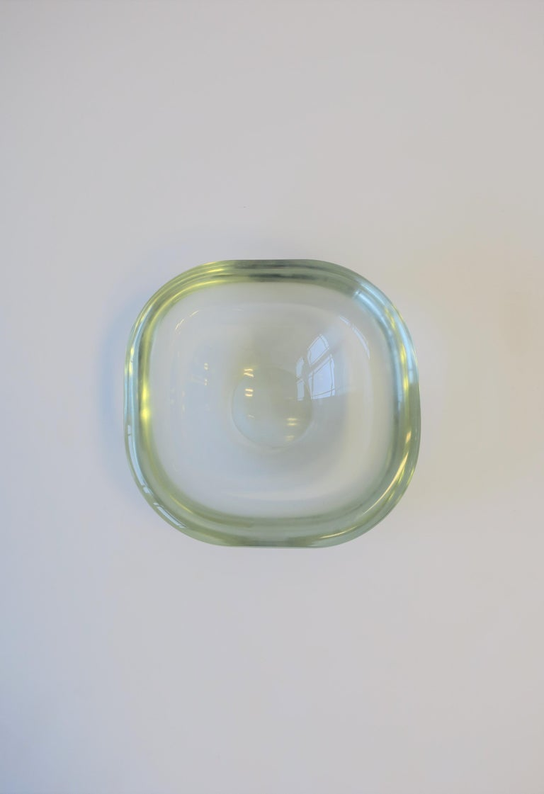 A very beautiful, substantial, signed Modern Italian Murano art glass bowl by designer Renato Anatra, circa mid-late 20th century, Italy. Bowl is clear/very light-green 'glass' hue with a smooth exterior and round edge. Measures 1.5