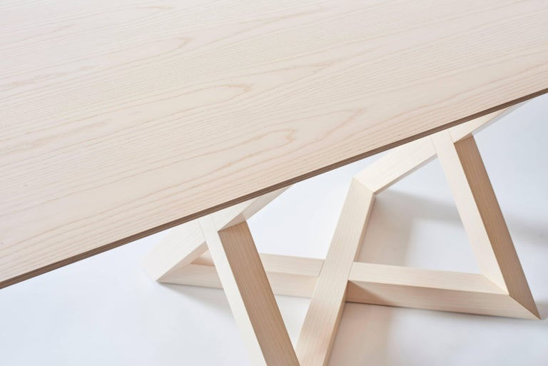 """""""RK"""" is a line of tables, which have like a support base a anamorphic and transmute matrix, a rigorous form. It's characteristic is base on the dynamic interlacement of the base, in single one three dimensional figure. The base, is a cross through a"""