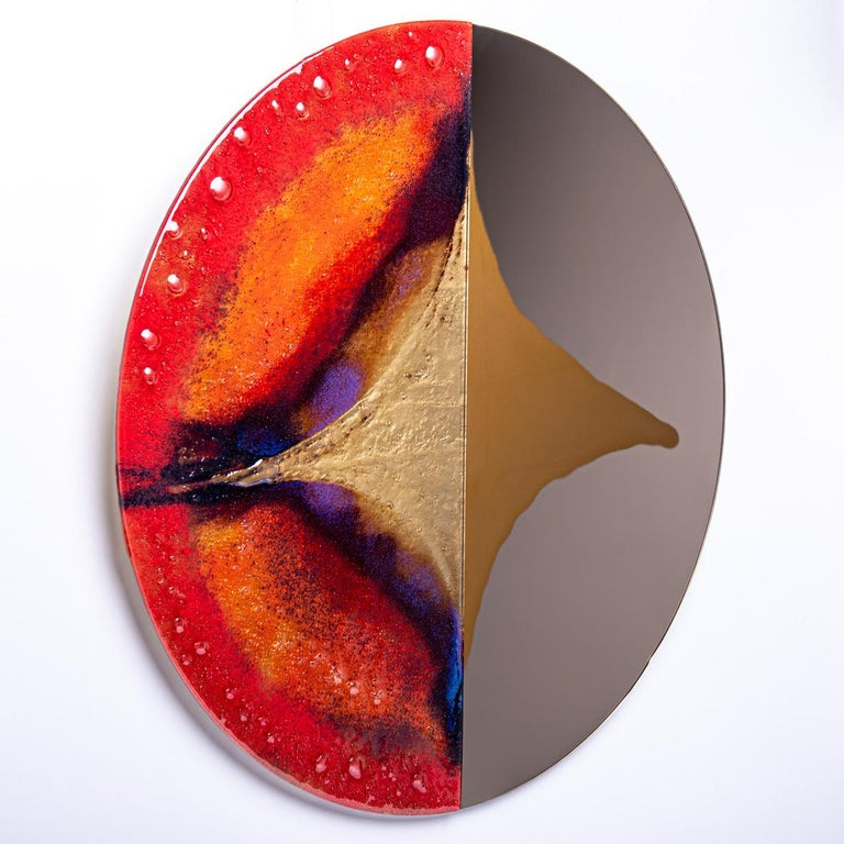 Contemporary and modern round mirror with Murano kind handmade glass colored using metal oxides in red, brown, cobalt and liquid metal. Limited collection signed by Edith Baranska showed for the first time in Milan, 2019. Each piece is unique and a