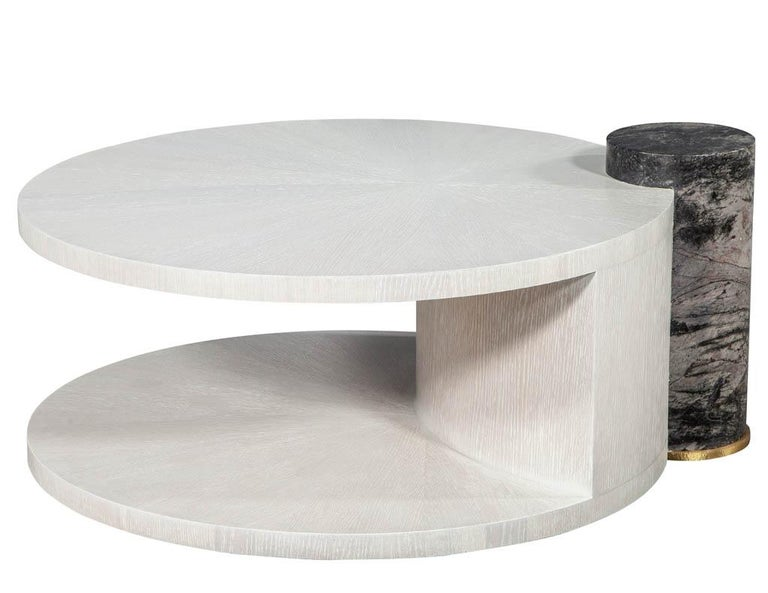 """Modern round oak cocktail coffee table with Marble Pillar. Featuring sunburst oak top and marble column.  Price includes complimentary curb side delivery to the continental USA.  Measures: Height of wood top: 16.5"""" height of marble top: 18.5""""."""