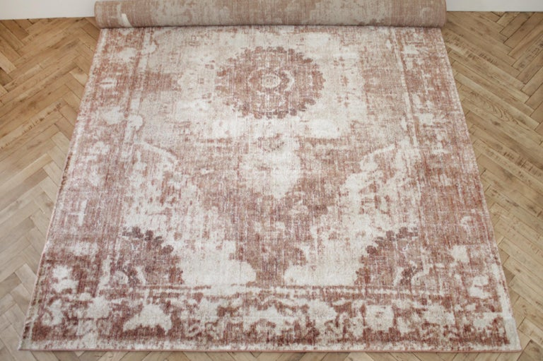 Modern rug in rust natural and cream tones