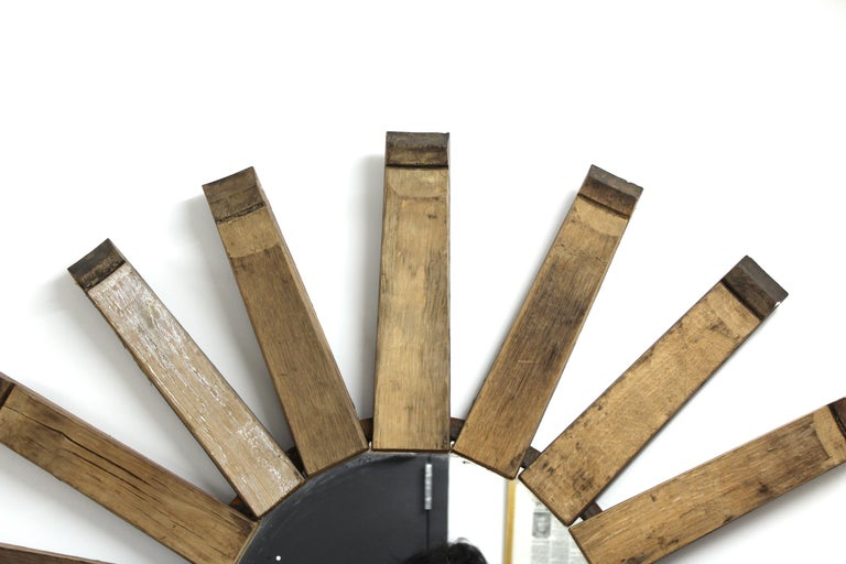 Modern rustic style wood wall mirror in sunburst shape made with reclaimed wood. From the estate of Nina Griscom.