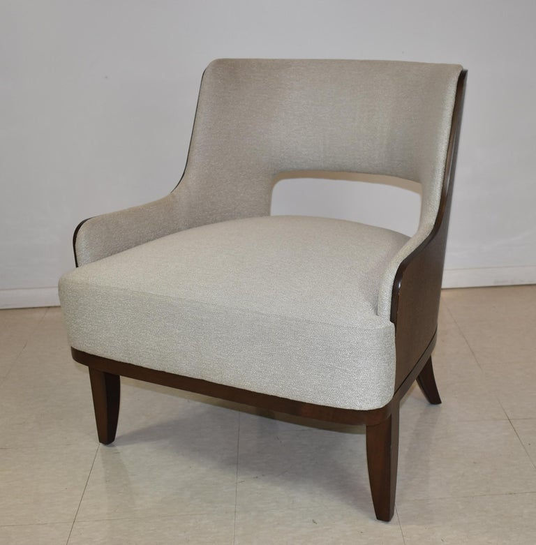 Modern Barbara Barry salon open back lounge chair for H B F. walnut frame with light grey upholstery fabric.