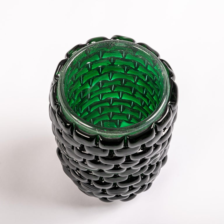 Contemporary venetian modernist vase signed cenedese with an interesting elongated modern organic shape, in a sophisticated  bottle green color with sculptural interruptions that make the outside appear as if covered with stones - creating an