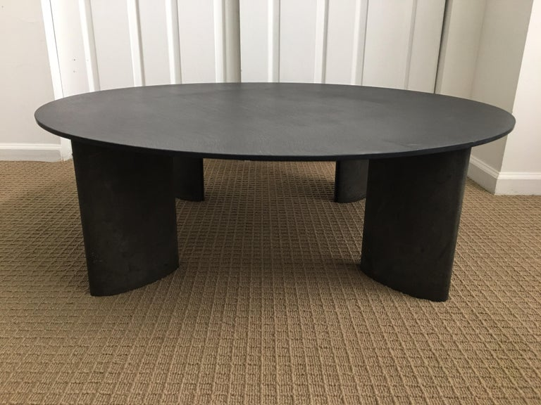 Modern metal aluminum coffee or cocktail table custom designed by Piotr Sierakowski for Koch and Lowy. Sculptural base features a matte black charcoal gray painted finish and is topped with a round natural slate top. Sierakowski also designed a