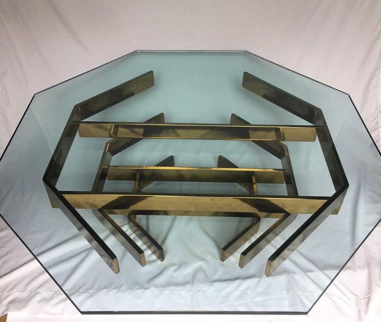Mid-Century Modern sculptural coffee table in the style of Paul Mayen and Milo Baughman.  Stunning gold brass plated metal base features interlocking stacked cityscape like flat bar stretchers which support a removable .75 inch thick octagon shaped