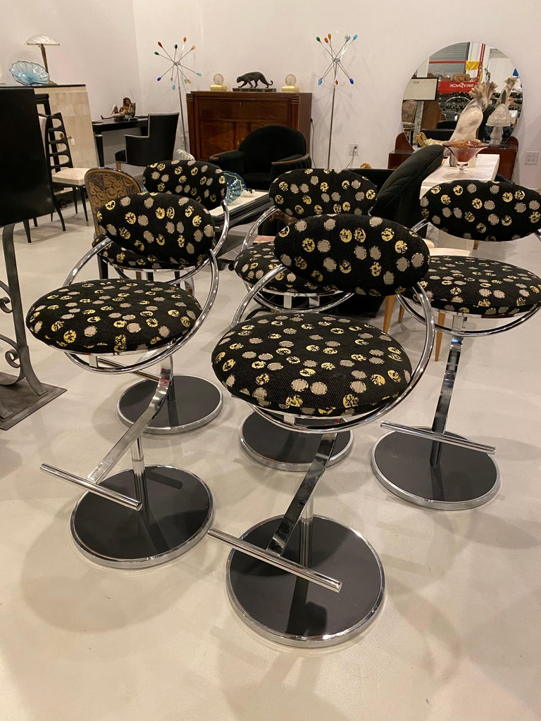 Set of five chrome bar stools. Reupholstery in good condition. Great for a bar or kitchen stools.