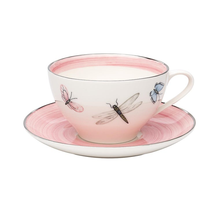 These completely handmade porcelain cups with saucers are painted by hand with a charming hands-free modern decor. The set comes as a set of six hand painted cups with a butterfly decor all-around and rimmed in three different colors. Rimmed by hand