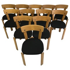 Modern Set of Twelve Light Wood Dining Chairs by Bruno Rey, 1970s