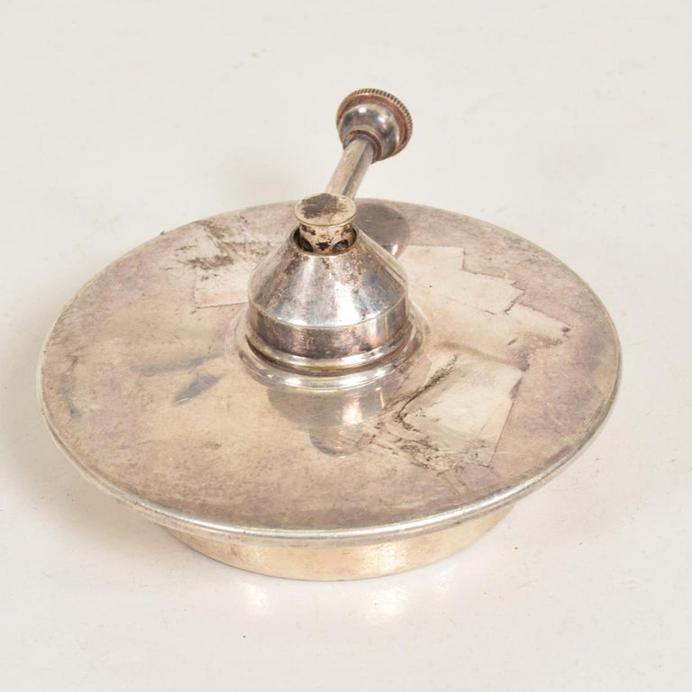 For your consideration, a modern silver plated chafing dish burner.  No information on the maker.   Dimensions: 4 3/4