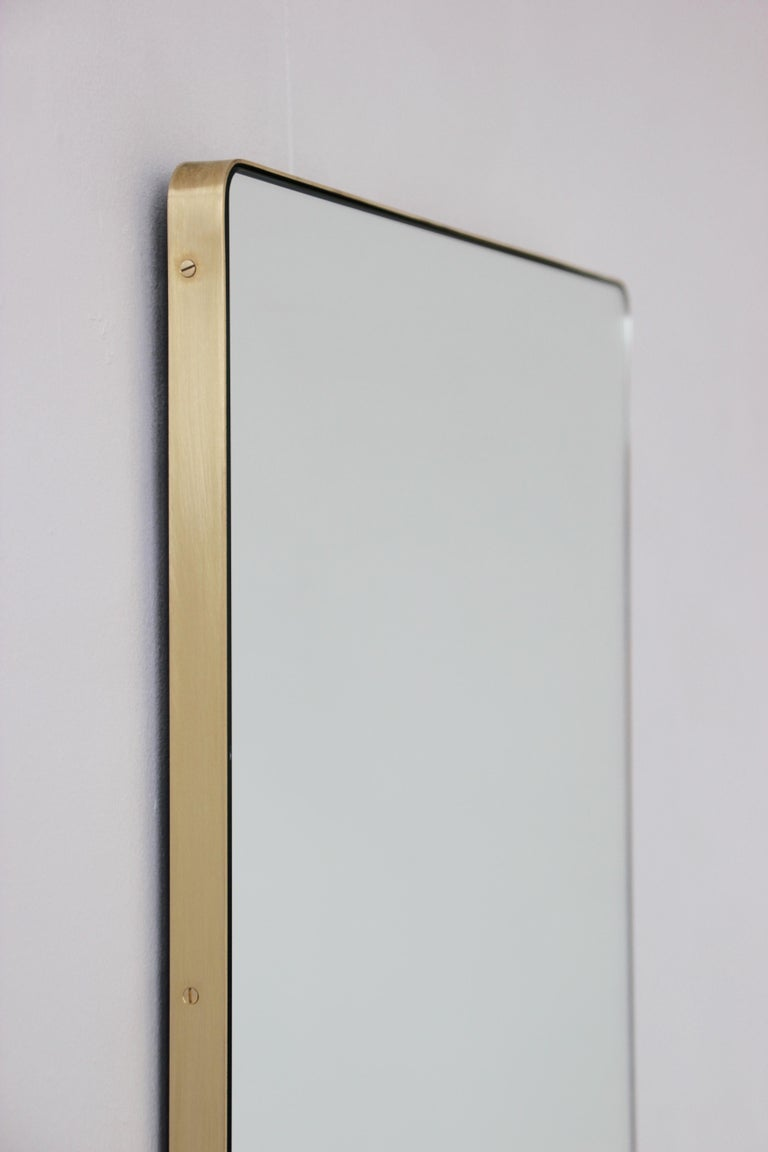Elegant rectangular mirror with a slim brass frame. The detailing and finish, including visible brass screws, emphasise the craft and quality feel of the mirror, a true signature of our brand. Designed and handcrafted in London, UK.  Supplied fully