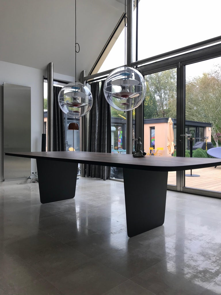 Composition Modern Carbon Claro Table with Walnut Top and thin Carbon Fiber Legs by Tokio. For Sale
