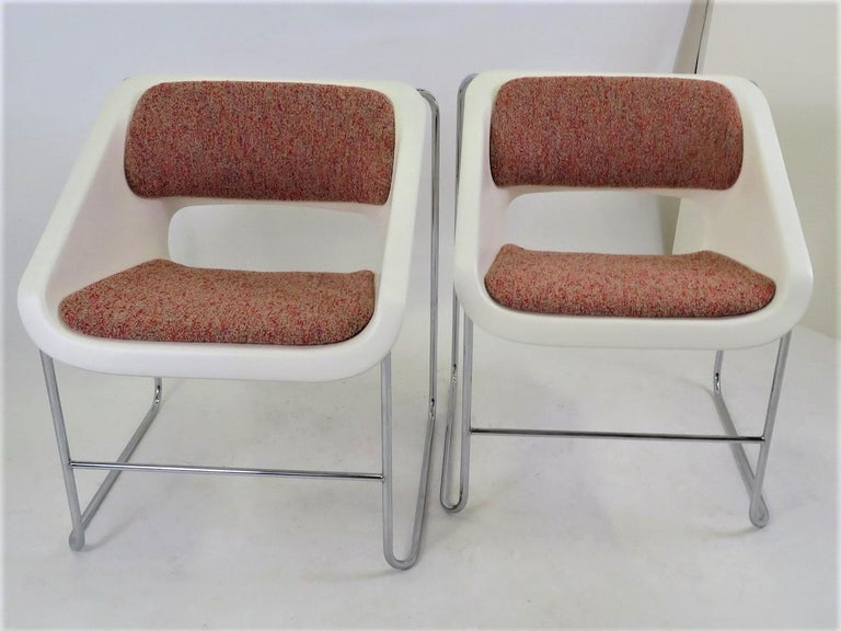 Pair of Space Age Mid Century Modern armchairs created by Paul Boulva for the Montreal Olympics in 1976 and produced by Artopex of Canada. The chairs sport a chromed metal frame with molded plastic seat with back and seat upholstered. The chairs are