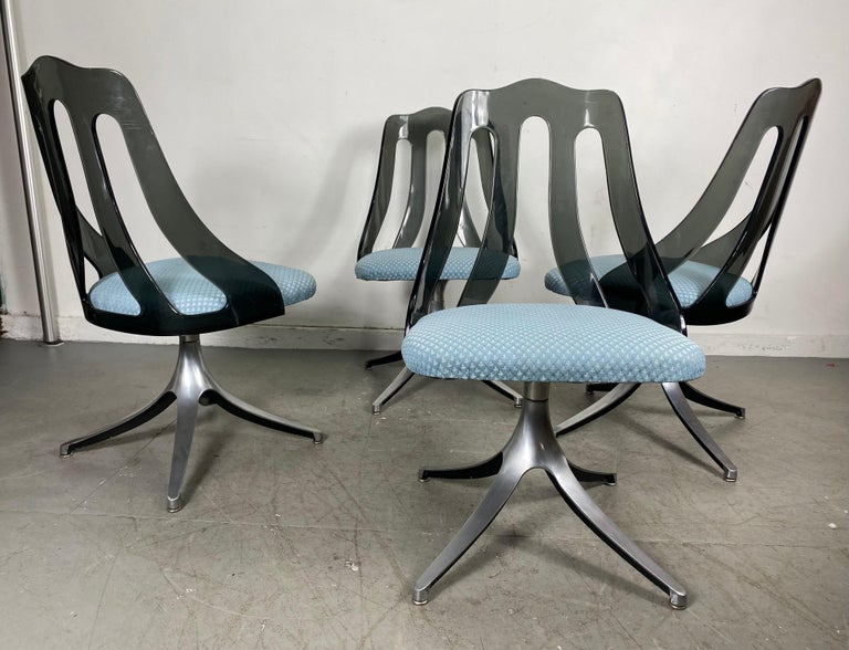Modern Space Age smoke Lucite and chrome dining chairs by Howell / Interlake, nice set of 4 matching swivel chairs, modernist space age design, smoked Lucite / Acrylic tops in wonderful original condition, seats have been reupholstered, (prob in the