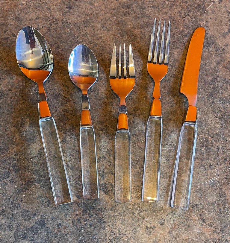 North American Modern Stainless Steel & Lucite Flatware Set for Seven Plus by Lifetime Cutlery For Sale
