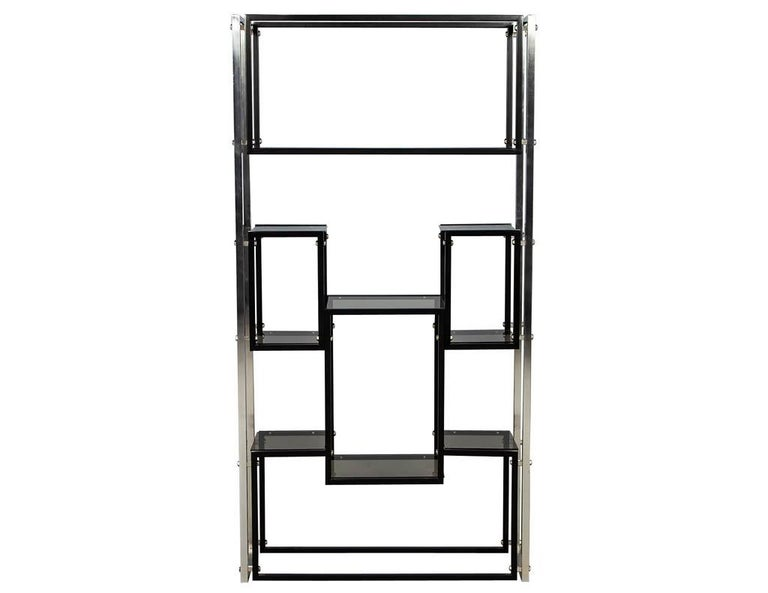 Modern stainless steel smoked glass étagère. Mid-Century Modern piece from the USA, manufactured in the 1970s. Featuring polished stainless steel frame with black painted details and smoked glass shelves. Price includes complimentary curb side