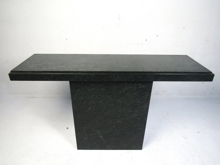 Simply stylish hall table made with a stone composite. Made to be tucked up against a wall, one side is open. Please confirm item location with dealer (NJ or NY).