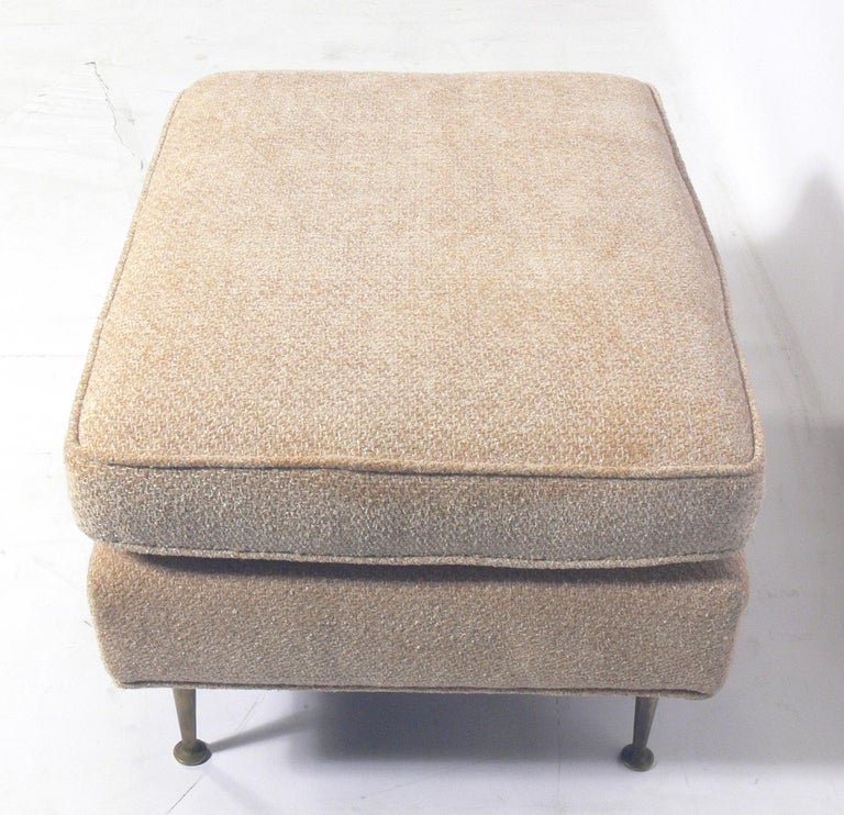 Modern stool or bench, attributed to T.H. Robsjohn-Gibbings, American, circa 1950s. This piece is currently being reupholstered and can be completed in your fabric at no additional charge. Simply send us three yards of your fabric after the purchase.