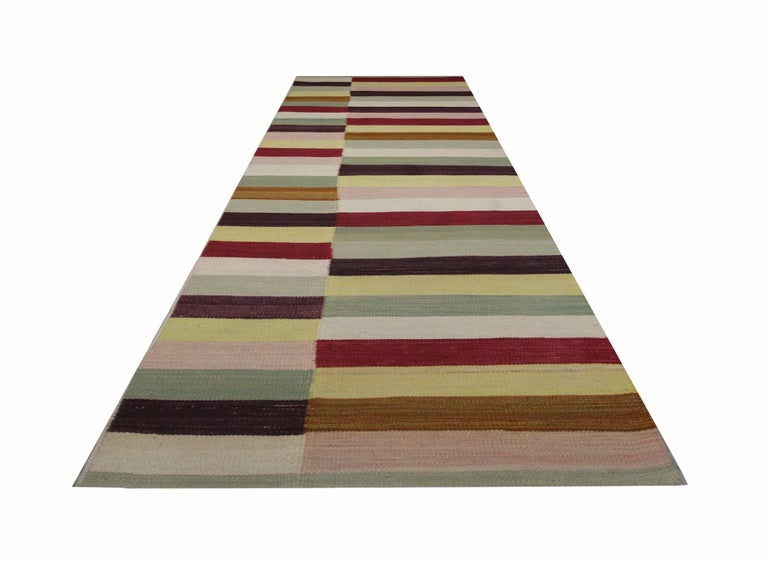 This modern striped carpet runner is a kind of Kilims indicating a particular flat-weave runner rug. It has been handmade stair runner in Afghanistan with the best wool and cotton by skilful weavers. Also, the high materials are of the highest