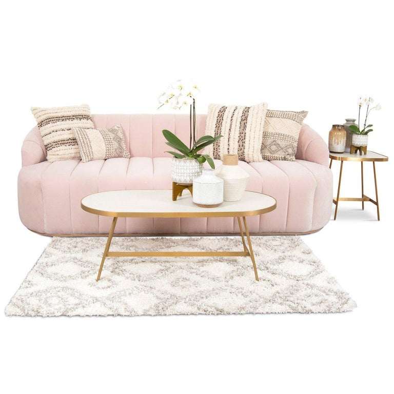 Introducing the Avalon sofa in velvet. This bold sofa features top to bottom channel tufted velvet in the front and a smooth back. A slim wood veneer toe kick adds a touch of natural beauty to this trendy sofa.