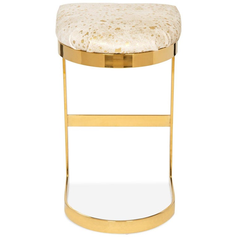 Similar in design to our Ibiza dining chair, except this stool is completely backless. Sitting atop of a brass curved base and featuring a rounded seat cushion adding comfort and style to your entertaining space. What an elegant way to have meals