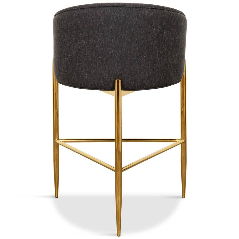 Similar in design to our Art Deco dining chair, this barstool is perfect for the bar. Sitting atop of a brass base with three long brass legs and featuring a curved upholstered back adding comfort and style to your entertaining space. What an