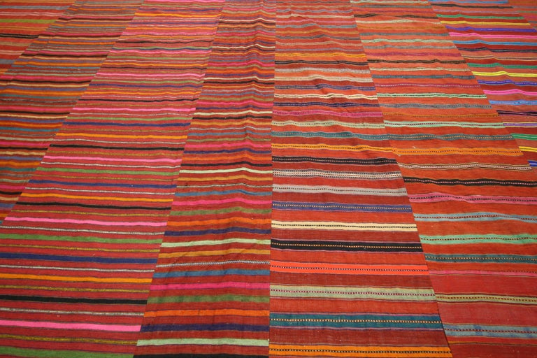 60655 Modern Style Vintage Turkish Kilim Flat-Weave Rug, Striped Kilim Area Rug. This handwoven wool vintage Turkish Kilim Jajim Kilim rug features a variety of colorful stripes composed of both wide and narrow bands forming a captivating visual