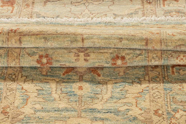 A hand knotted modern Sultanabad runner rug with an all over geometric motif on a beige/tan field. This rug measures: 3' x 14'7