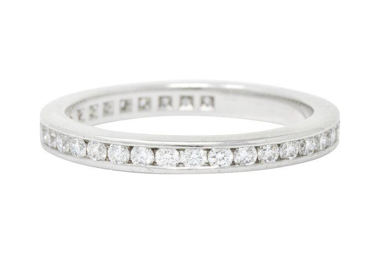Eternity style band ring channel set fully around by round brilliant cut diamonds  Diamonds are very well matched F/G in color with VVS clarity, weighing approximately 0.75 carat total  Fully signed Tiffany & Co.  Stamped PT950 for platinum  Size: 4