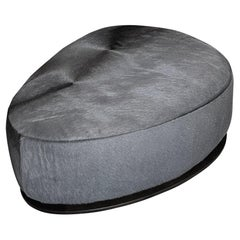 Modern Triangle Ottoman with Walnut Base Upholstered in Leather by Edelman