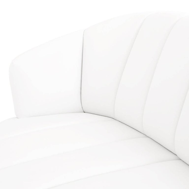 Mid-Century Modern Modern Tufted Pearl White Faux Leather Sofa with Channel Tufting & Brass Toekick For Sale