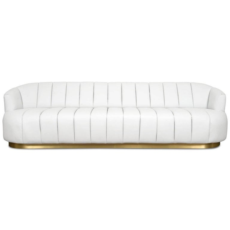 Contemporary Modern Tufted Pearl White Faux Leather Sofa with Channel Tufting & Brass Toekick For Sale