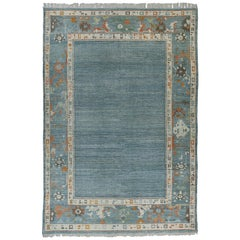 Modern Turkish Oushak Rug with Blue Field and Colorful Floral Border Designs