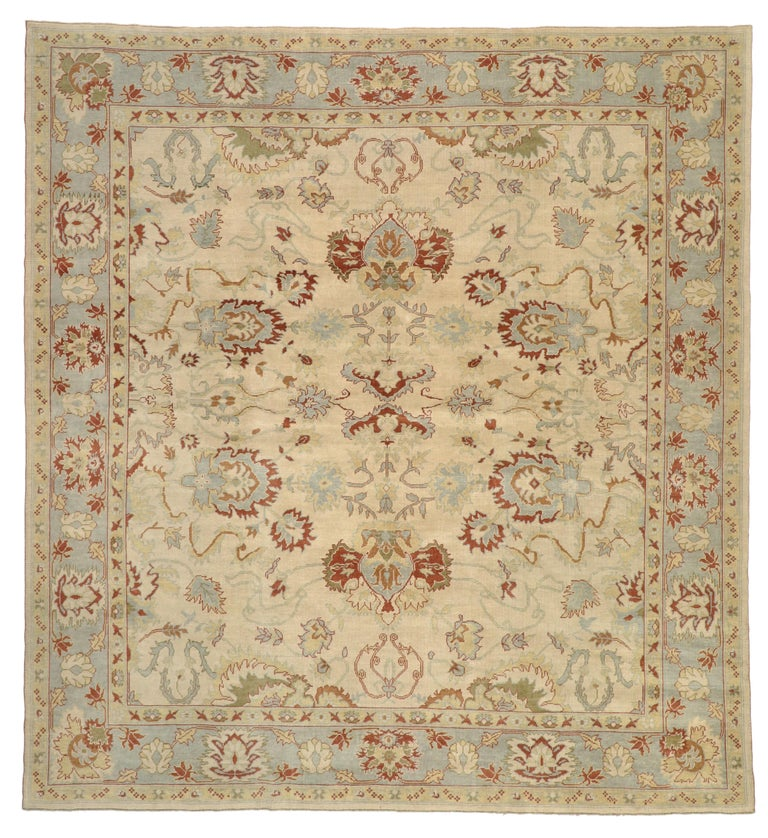 This modern Turkish Oushak rug with transitional style has many layers that perform well together with a symphonic energy that captivates immediate attention. Featuring an all-over pattern of stylized geometric motifs in a warm beige field, this