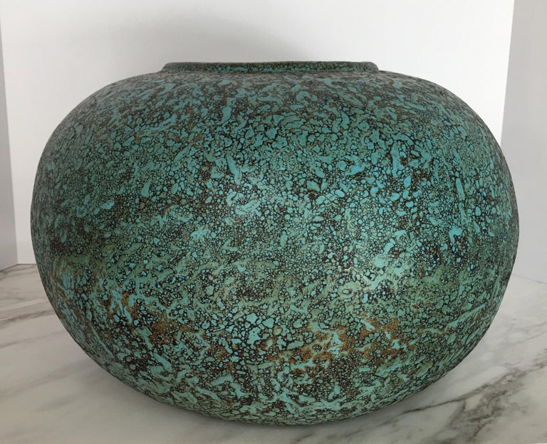 Large round handmade terracotta vase featuring a textural turquoise verdigris-like finish with brown/black burned details. This large scale sculptural centerpiece vase or bowl is truly a statement accessory.