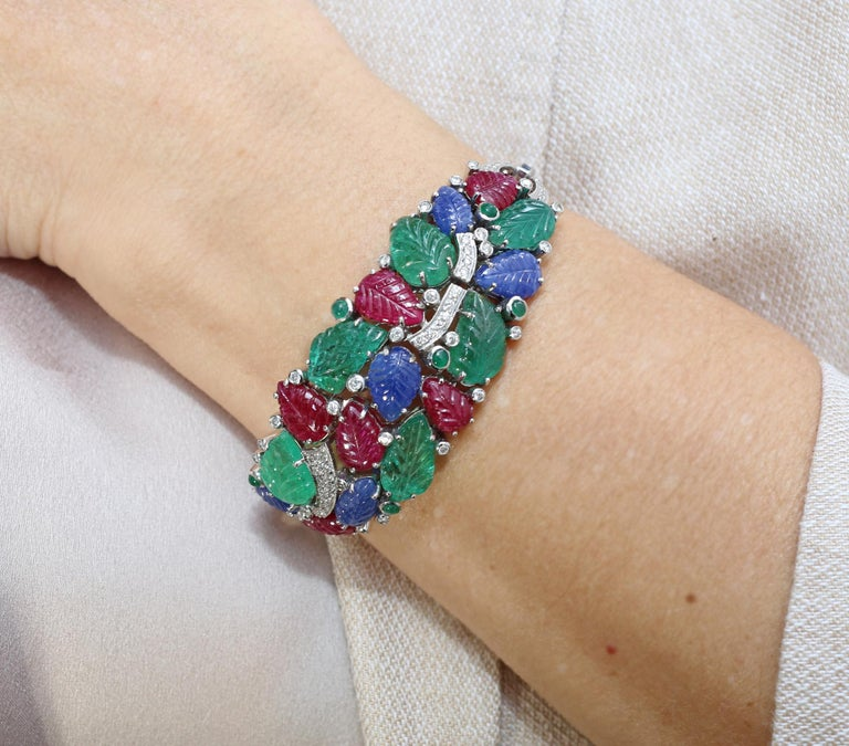 Tutti-Frutti Bracelet Rubies Sapphires Emeralds Diamonds 18 K Gold. An elegant Tutti-Frutti bracelet in the style of the Art Deco era. Rubies, Sapphires, Emeralds. This item is a modern, 1996, interpretation of the great idea. The bracelet is made