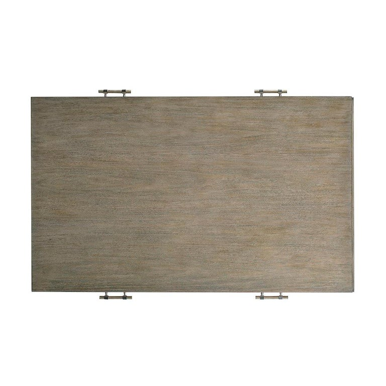 Modern coffee table with two drawers, beaded trim detail, stainless steel and wood hardware, stainless steel ferrules, with a light warm