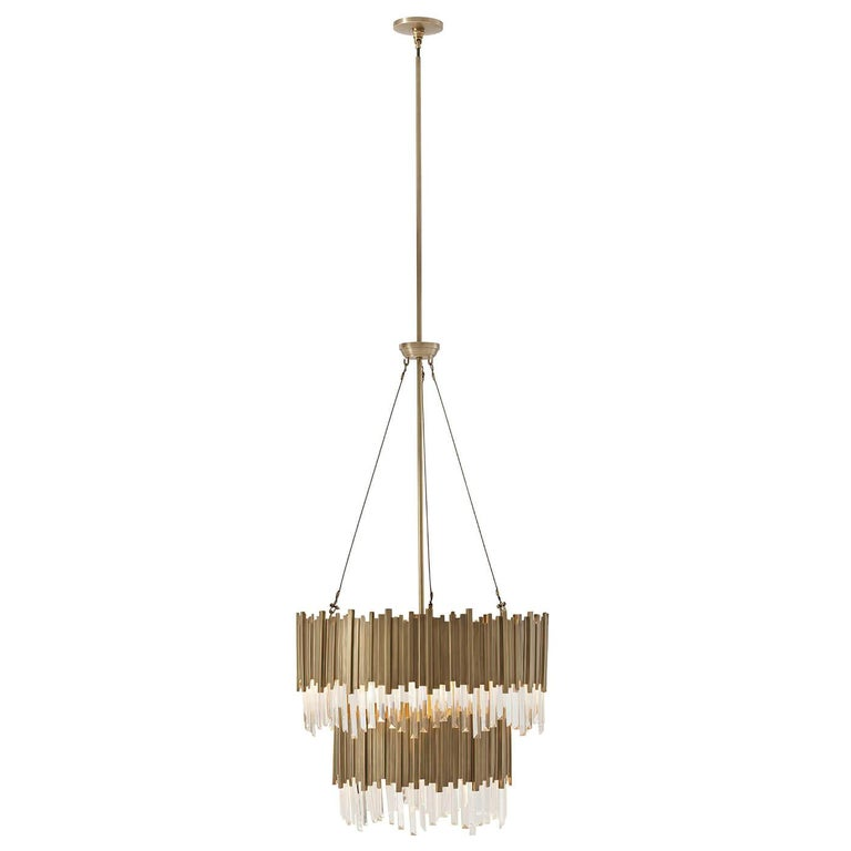 Modern two-tiered brass chandelier with brass stacked square rods, polished optical quality glass pendant crystals. 108