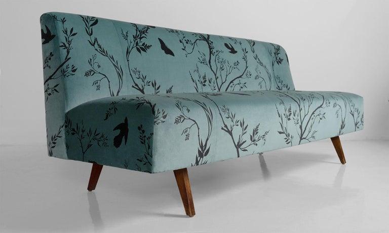Modern velvet sofa, Italy, circa 1950.  Newly upholstered velvet sofa on simple wooden legs.