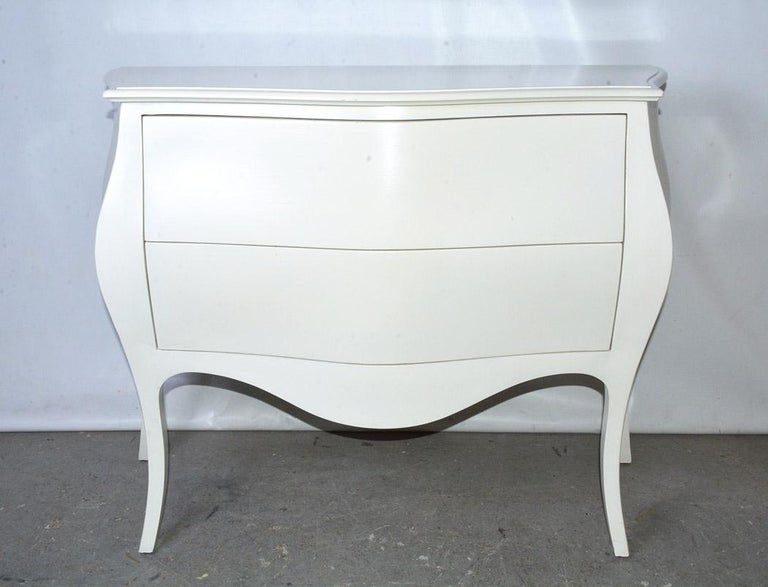 The modern chest with two drawers in the Venetian curvy or Bombay style is hand-crafted, as well as hand-painted in glossy cream. Picture it in the living room or bed room or even the entrance hall.