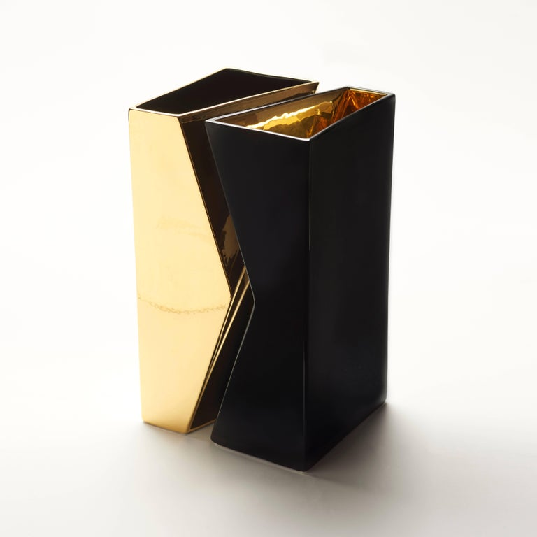Pair of vases black with gold inside and gold with black inside, in ceramic, essential geometry, pure and unique forms, represent the direction. The separation or the union is defined by color. Separated or united, as well as they can contain