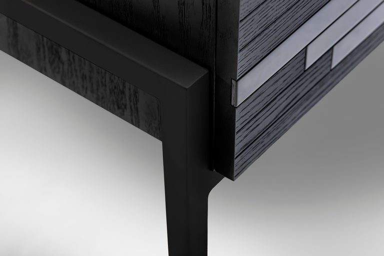 Storage cabinet with doors designed by Larissa Batista in Black Metal  Modern cabinet featuring unique mixed black lacquer and black oak. Social media hit high-end furniture by designer Larissa Batista, a cabinet as daring as it is elegant. This