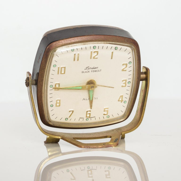 Mid-Century Modern charming Vintage Linden Alarm Clock wind up in aged golden Brass with green accents made Black Forest West Germany.  Fabulous flexible rotating design and footed frame. Measures: 3
