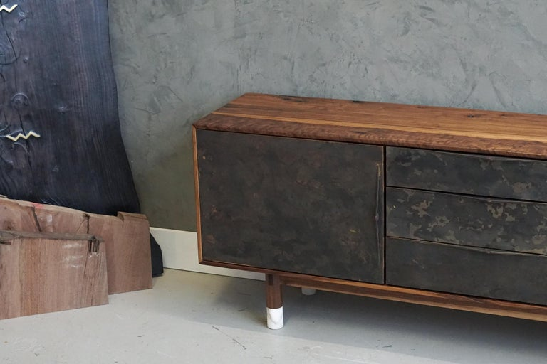 Constructed from walnut and alabster the Wabi Credenza gets its name from the patina'd / painted brass door fronts, encouraging you to embrace the imperfections. Featuring splined miter joints, alabaster feet, leather lined drawers with Blum soft