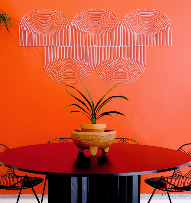Bend Goods wire furniture This interactive wire decor is designed to brighten and enhance your walls inside or out. The Modular Art Piece lets you be the designer and create horizontal or vertical shapes that make a unique statement. If you're