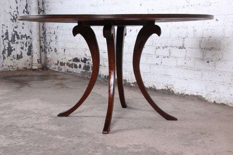 20th Century Modern Walnut Saber Leg Dining Table with Inlaid Starburst Parquetry Top For Sale