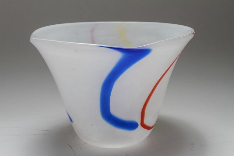 Modern Waterford Irish handmade glass / IHG art glass bowl with cased-glass white and primary colors, red, yellow and blue running down in stripes. Label: