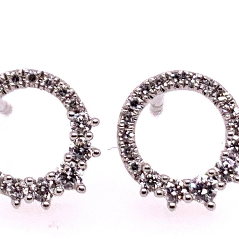 Stunning Modern 14k White Gold 0.22 Carat Natural Colorless Diamond Circle Earrings. The pair is set with 36 round brilliant diamonds and the total weight is 1.3 grams.