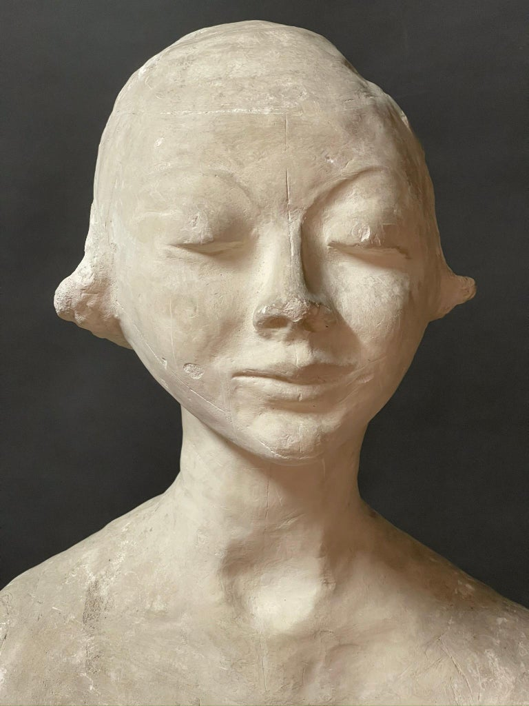 Very interesting plaster sculpture depicting a lovely young woman.  The author is an Italian artist Ida Fua who worked in Torno near Como.  The elegant, elongated neck, recalls the Italian Maestro Amedeo Modigliani.   This artwork is shipped from