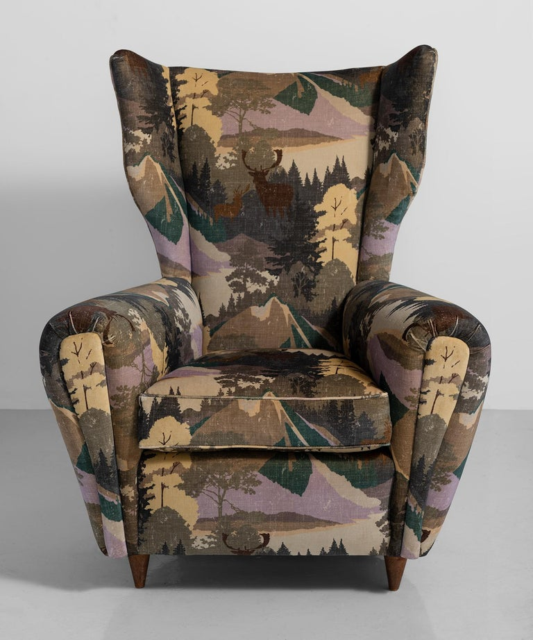 Modern wing chair, Italy, circa 1950.  Dynamic form, newly reupholstered in nature themed velvet.
